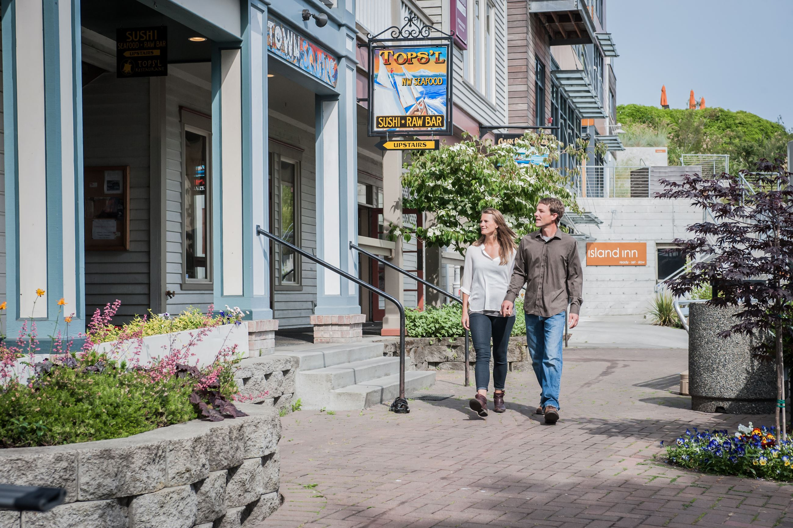 Couple Walking By Businesses